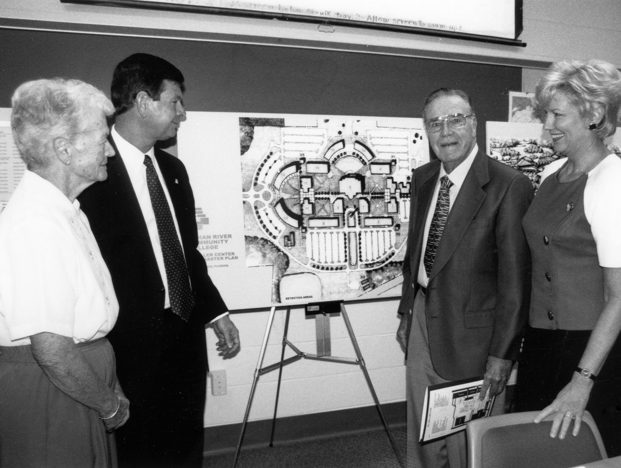 Marge Richardson, left, IRSC President Dr. Edwin Massey, Dan Richardson and Mary Graves, trustee with the District Board of Trustees, view the expansion plans for the Mueller Campus in Vero Beach. The effort to open a campus of Indian River State College in the Vero Beach area started when James and Valeda Mueller gave land for it and the Richardsons provided seed money to launch the project.