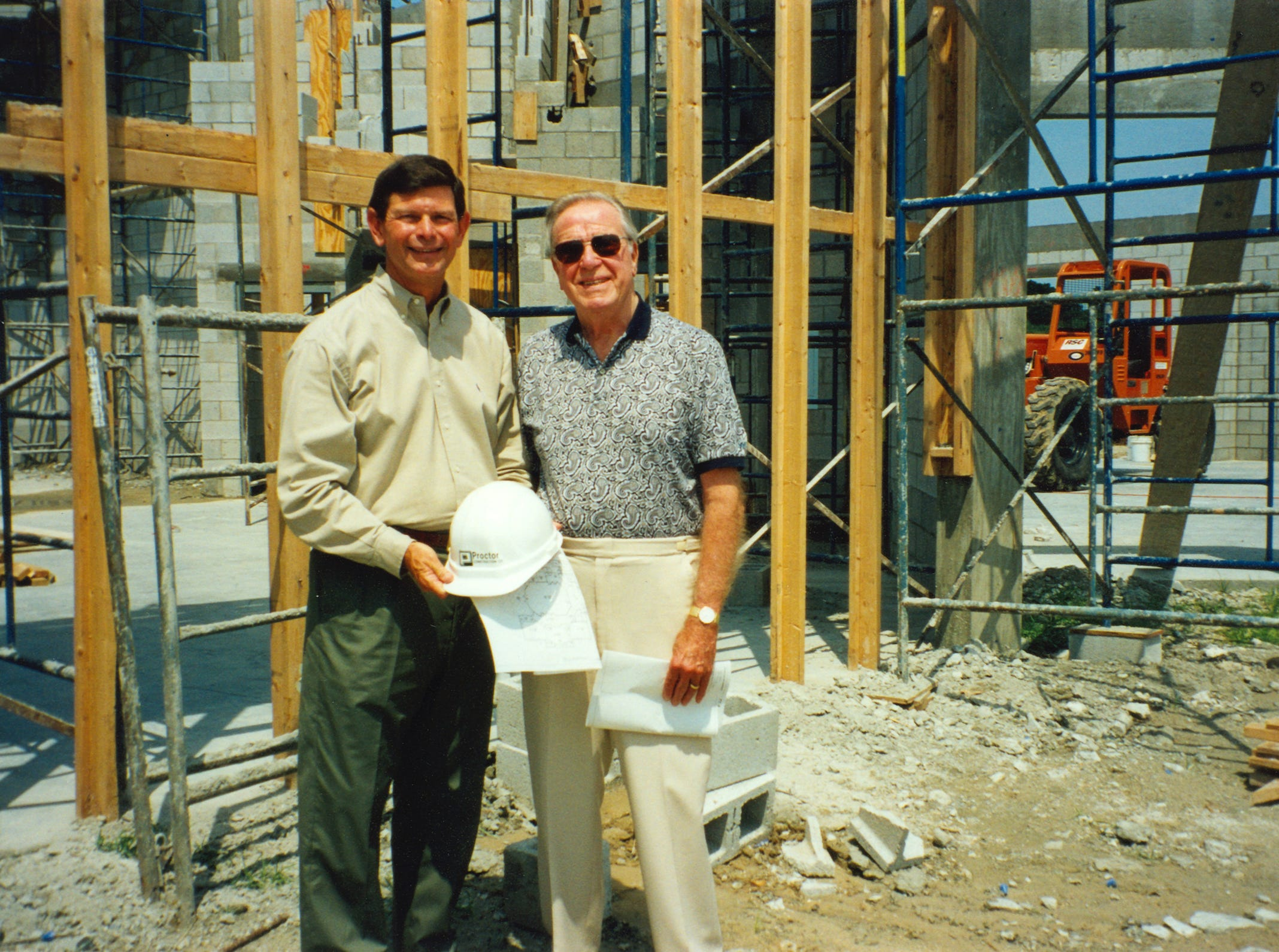 Indian River State College President Dr. Edwin Massey, left, and Dan Richardson tour the Richardson Center site in 2000 during the center's construction.