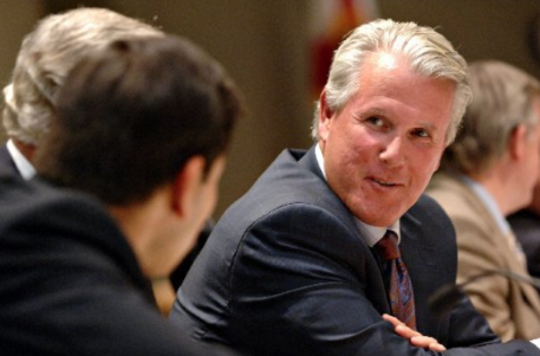TALLAHASSEE - Rep. Stan Mayfield, right, talks to Rep. Joe Negron during a legislative session on April 4, 2006.