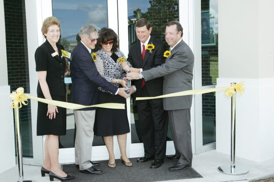 Ann Decker, left, executive director of the Indian River State College Foundation; John Schumann, Kathi Schumann, IRSC President Dr. Edwin Massey, and Provost Dr. David Sullivan at the Schumann Center dedication in 2007.