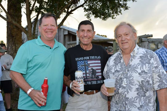 Mike Mahoney, left, Charlie Hayek and Ed Hyer at the 2018 Peter W. Busch Family Foundation's Wild Game Dinner.
