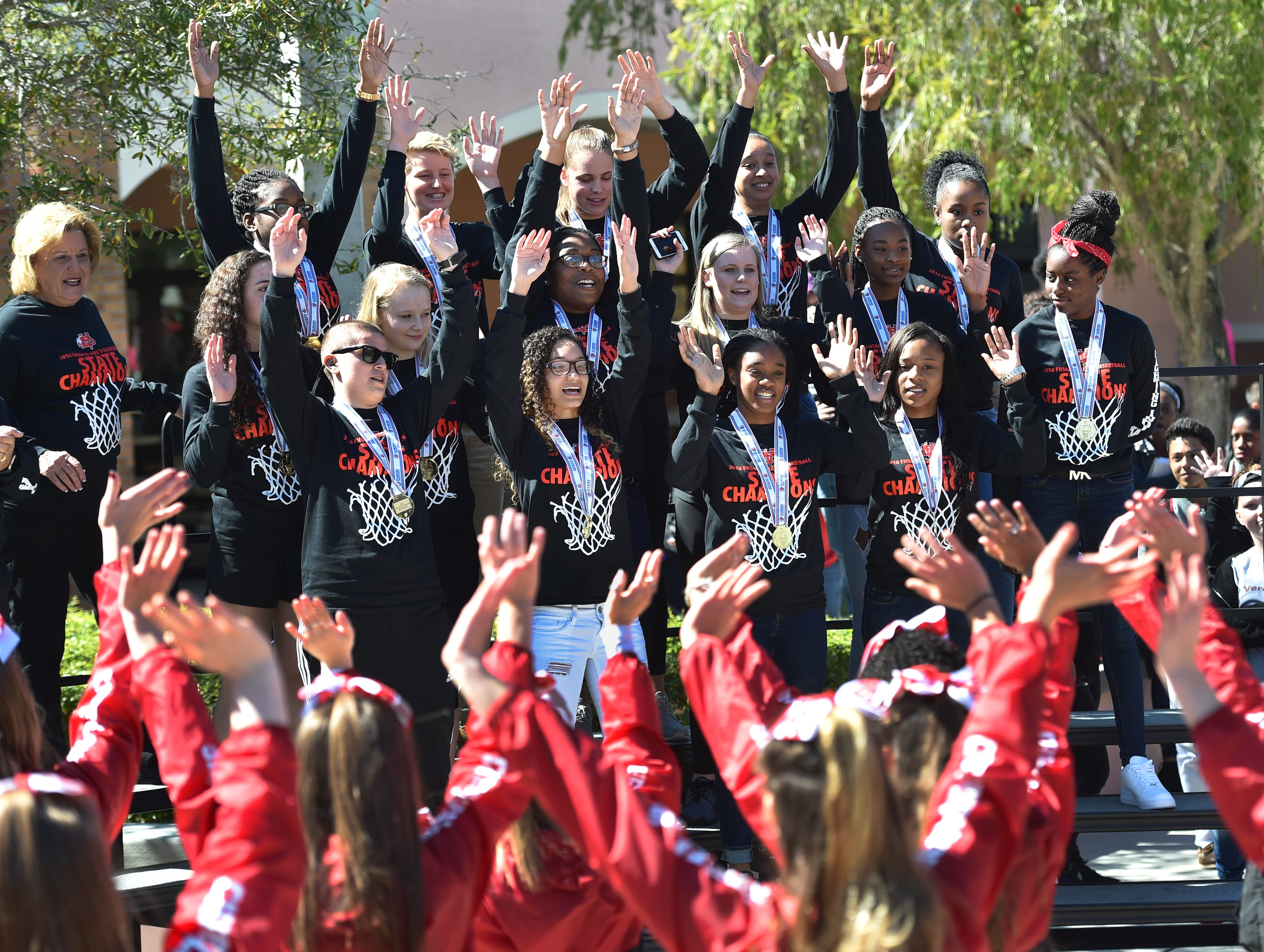 """It's fantastic, to have the school come out and support us like this and show their love, what better thing can you ask for, this is what Vero Beach High School is all about,"" said Rahshard Morgan, Vero Beach High School girls basketball head coach, as his team (top) celebrates with cheerleaders, band, and students during a brief pep rally honoring their winning the Florida High School Athletic Association class 8A Girls Basketball State Championship. The team beat Boca Raton to win the championship 77-68 after two overtimes, school Principal Shawn O'Keefe said. ""After 41 years of girls basketball, this is the first state championship."" To see more photos, go to TCPalm.com. (ERIC HASERT/TREASURE COAST NEWSPAPERS)   Rahshard Morgan, cq Shawn O'Keefe, cq PHOTOGRAPHED: Thursday FEBRUARY 25, 2016"