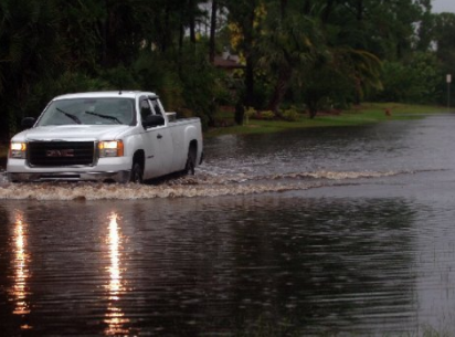 VERO BEACH - A truck passes through 17th Land in the Highlands on Wednesday as the street remains flooded. 8/20/2008