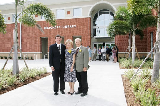 Indian River State College President Dr. Edwin Massey, left, with Sandy and Bob Brackett outside the Brackett Library. The newest addition to the Mueller Campus is the joint-use library, which serves IRSC students and Indian River County residents. Dedicated in 2009, the facility is named in recognition of the Bracketts, who generously backed construction of the library.