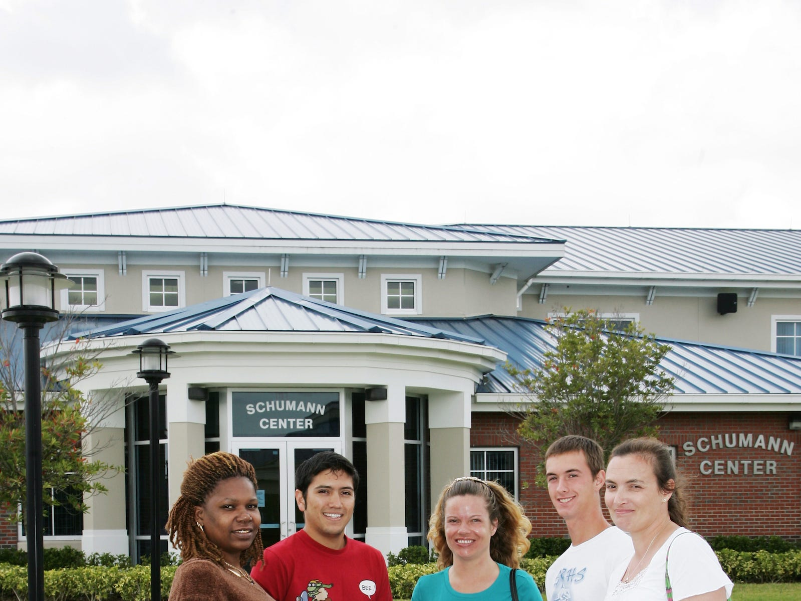 Students outside the Schuman Center on the Indian River State College Mueller Campus in Vero Beach.