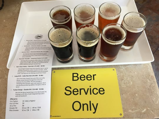 """A tray of tasters awaits pick-up by a patron at the """"beer service only"""" counter inside the tasting lounge shared by Flat Fish Brewing Co. and Cantara Cellars in Camarillo."""