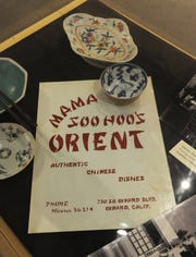 "CHUCK KIRMAN/THE STAR A menu from Mama Soo Hoo's Orient was on display at the Museum of Ventura County in 2016. It was a part of the Smithsonian traveling exhibit ""I Want the Wide American Earth: An Asian Pacific American Story."""