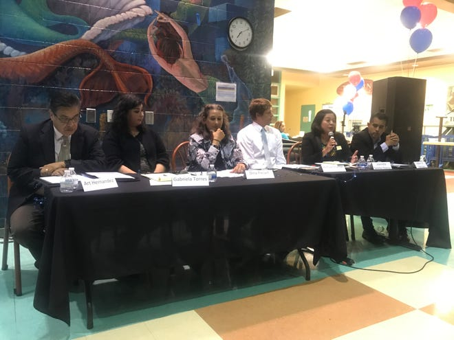 Candidates for the Ventura County Community College board discuss equity at the Latino Issues Forum at Pacifica High School in Oxnard.