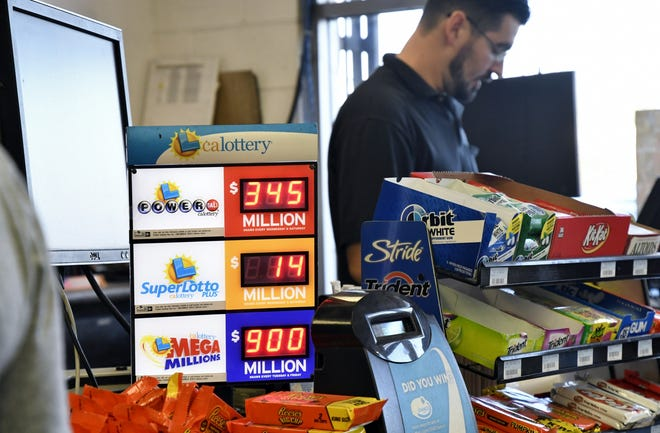A California Lottery digital board shows the amount up for grabs in the Mega Millions and Powerball lottery at 4 Seasons Handy Mart in Visalia on Wednesday, October 17, 2018.