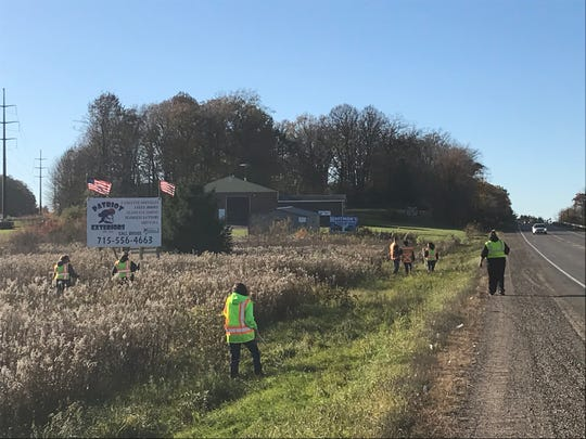 Volunteers search a ditch near Barron, Wisconsin, on Thursday, Oct. 18, 2018, looking for any evidence related to missing 13-year-old Jayme Closs. The girl hasn't been seen since before her parents were discovered shot to death early Monday in the family home.