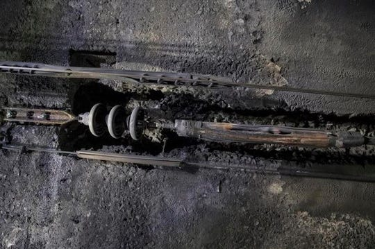 Cables in the Hudson River rail tunnel are corroded during a tour that began on Wednesday, Oct. 17, 2018, in New York. New York Gov. Andrew Cuomo wants President Donald Trump to get an up-close look at the level of damage in the century-old tunnel, which was damaged in Superstorm Sandy in 2012. The Democrat toured the tunnel  and plans to send video to Trump in a bid to get the administration to commit money to a $13 billion project to build a new tunnel. Trump administration officials have clashed with New Jersey and New York over a funding plan.