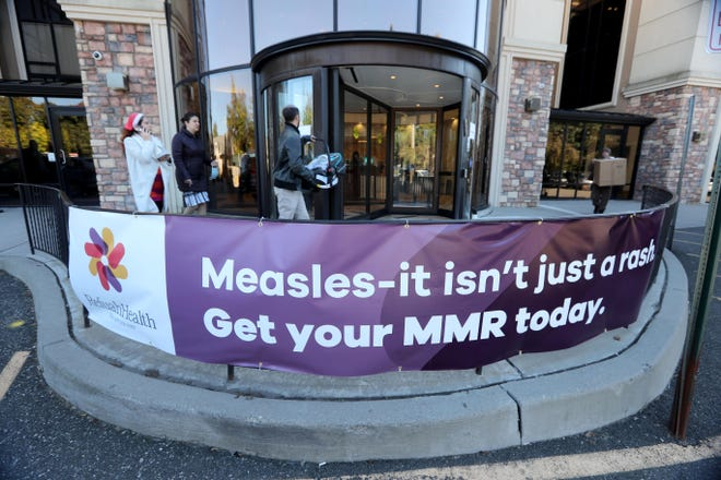 People enter the Refuah Health Center in Spring Valley on Oct. 18. Amid the largest outbreak of measles in Rockland County in the last 20 years, residents are being encouraged to check their vaccination status and get the measles vaccine in not already immune.