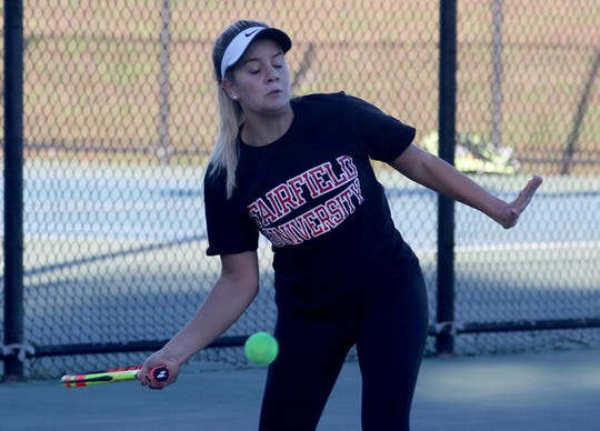 Liano Campos of Ursuline returns a shot during a doubles match at the Section 1 girls tennis championships at Harrison High School Oct.18, 2018.