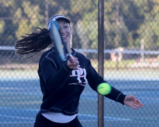Ellie Margolin of Byram Hills returns a shot during a doubles match at the Section 1 girls tennis championships at Harrison High School Oct.18, 2018.