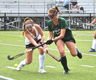 Mamaroneck's Sophie Showers (l) and Lakeland's Emma Halderman battle during game last month.