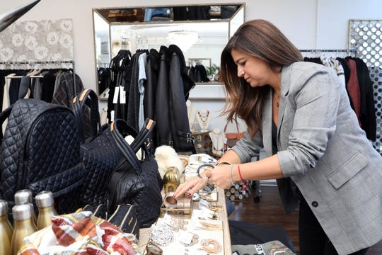 Owner Dawn Pasacreta organizes the jewelry at Lola New York, a women's clothing and accessories boutique in White Plains, Oct. 18, 2018. Pasacreta and her friend opened the shop up about four years ago and their second in Tuckahoe last year.