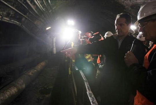 New York Gov. Andrew Cuomo inspects the South Tube of train tunnels running between New York and New Jersey during a tour that began Wednesday, Oct. 17, 2018. Cuomo wants President Donald Trump to get an up-close look at the level of damage in the century-old tunnel, which was damaged in Superstorm Sandy in 2012. The Democrat toured the tunnel and plans to send video to Trump in a bid to get the administration to commit money to a $13 billion project to build a new tunnel.
