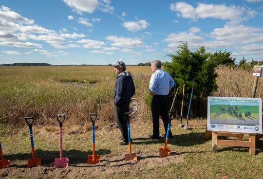 Gov. John Carney, left, and Delaware Environmental Secretary Shawn Garvin look out over the marsh where the Marvel Saltmarsh Preserve Boardwalk will be constructed near Slaughter Beach.
