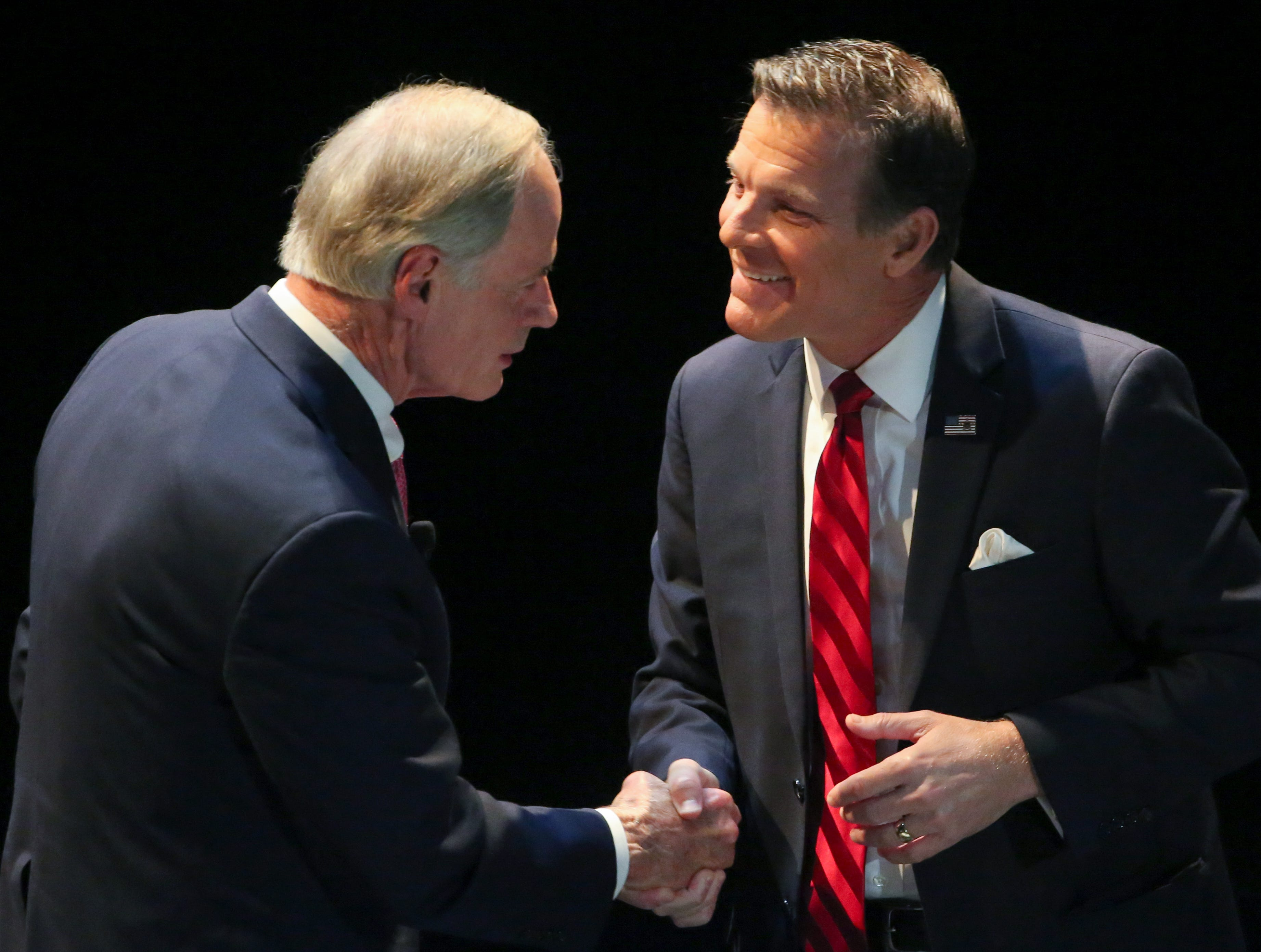 US Senate candidates from Delaware Democrat incumbent Tom Carper (left) and Republican challenger Rob Arlett meet after a debate at the University of Delaware's Mitchell Hall Wednesday.