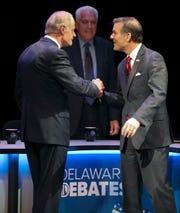 Delaware Senate candidates Democrat incumbent Tom Carper (left) and Republican challenger Rob Arlett meet before a debate at the University of Delaware's Mitchell Hall Wednesday.