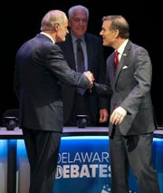 Delaware Senate candidates Democrat incumbent Tom Carper (left) and Republican challenger Rob Arlett meet before a debate at the University of Delaware's Mitchell Hall Wednesday.