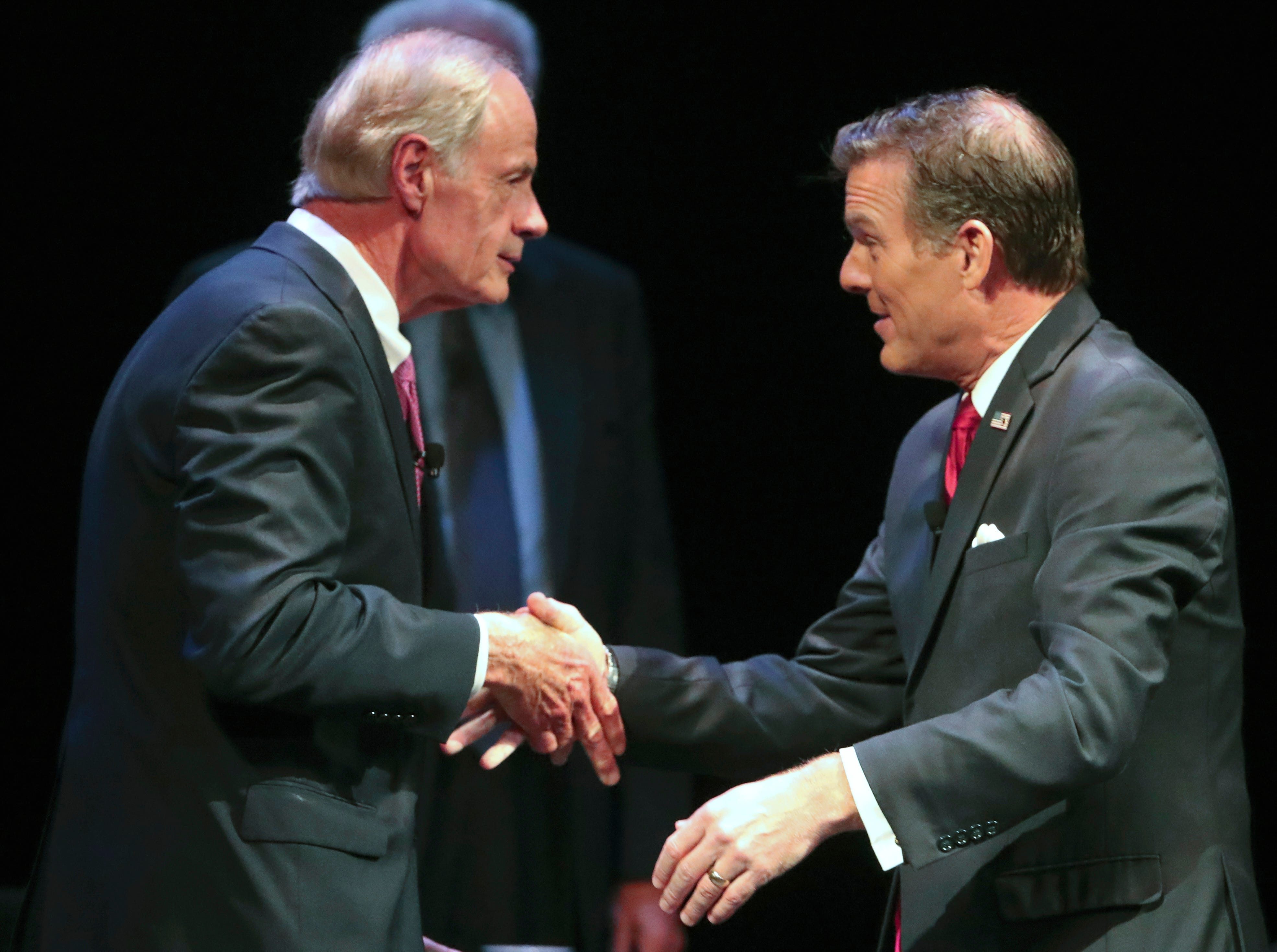 US Senate candidates from Delaware Democrat incumbent Tom Carper (left) and Republican challenger Rob Arlett meet before a debate at the University of Delaware's Mitchell Hall Wednesday.