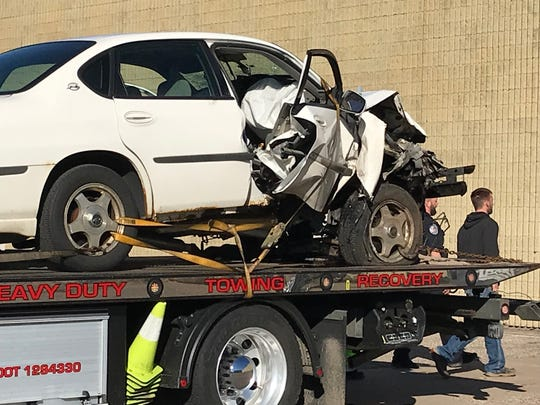 A car that crashed into the back of the Crestview Church, 1000 E. Riverview Expressway, Wisconsin Rapids, sits on the back of a tow truck Thursday morning.
