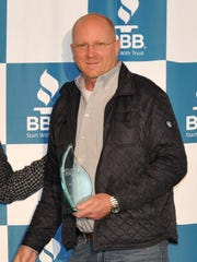 Waters Ag Owner Ronnie Waters posed for pictures after winning the Better Business Bureau 2018 Torch Award, Medium Category.