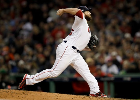 Boston Red Sox relief pitcher Ryan Brasier throws against the Houston Astros during the seventh inning in Game 2 of a baseball American League Championship Series on Sunday, Oct. 14, 2018, in Boston.