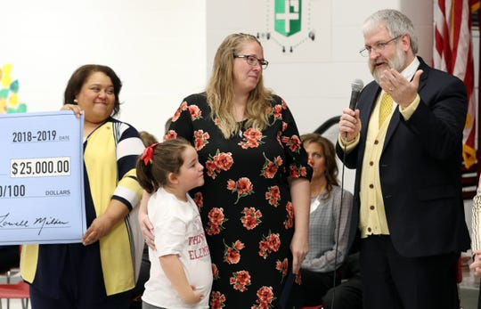 Paolo DeMaria, Superintendent of Public Instruction at the Ohio Department of Education, speaks after Thornville Elementary School Fourth Grade teacher Krista Trent was named the Milken Family Foundation Milken Educator Award Winner on Thursday. With Trent is Trent's daughter Lydia.