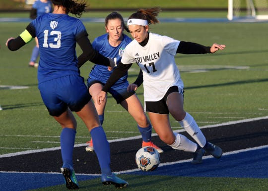 Tri-Valley's Karsan Ross tries to get past a pair of Zanesville players. Ross will join former Scottie, Chloe Williams, on the Marietta women's soccer team.