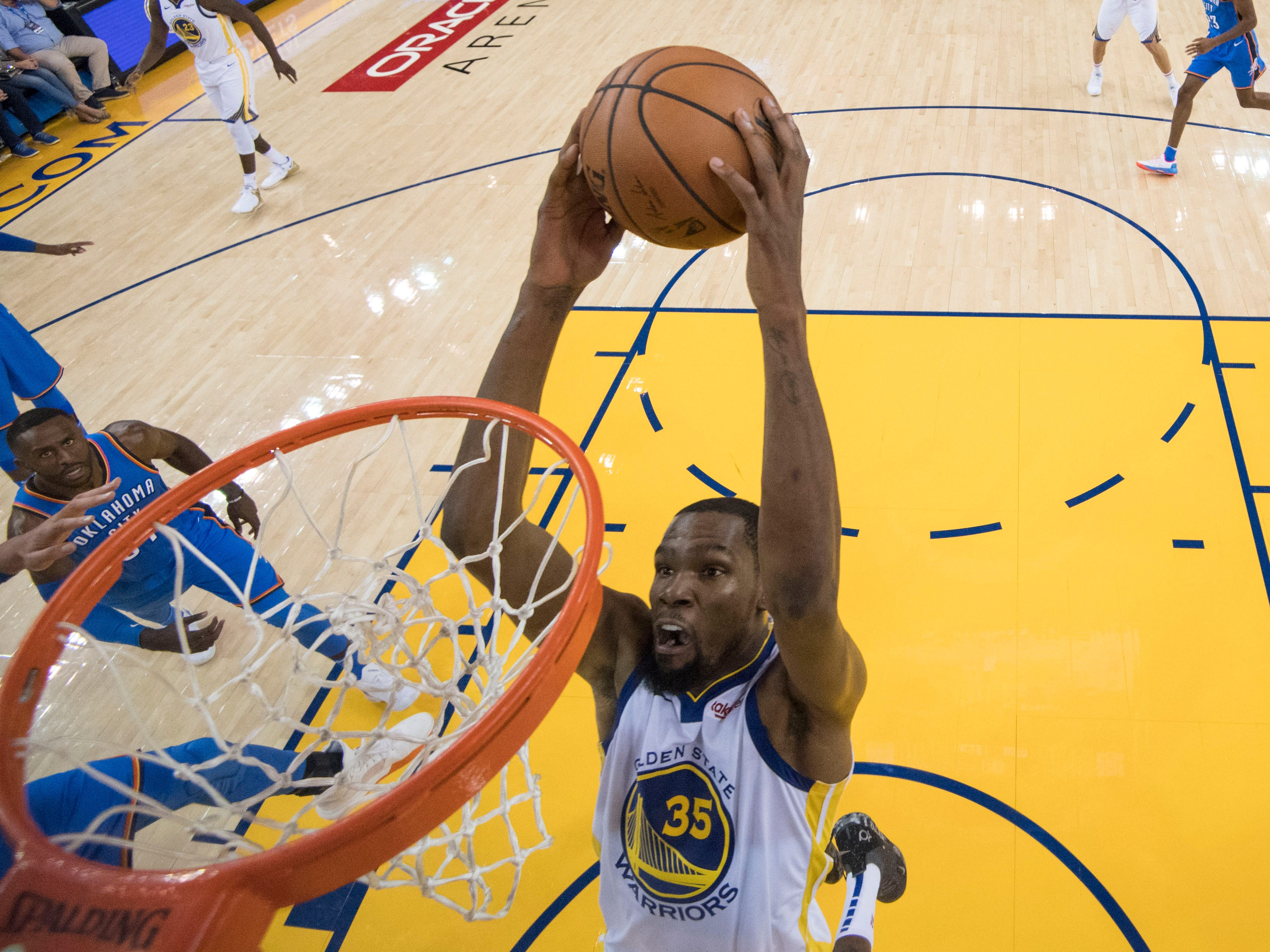 Oct. 16: Golden State Warriors forward Kevin Durant dunks the basketball during the first half against the Oklahoma City Thunder at Oracle Arena.