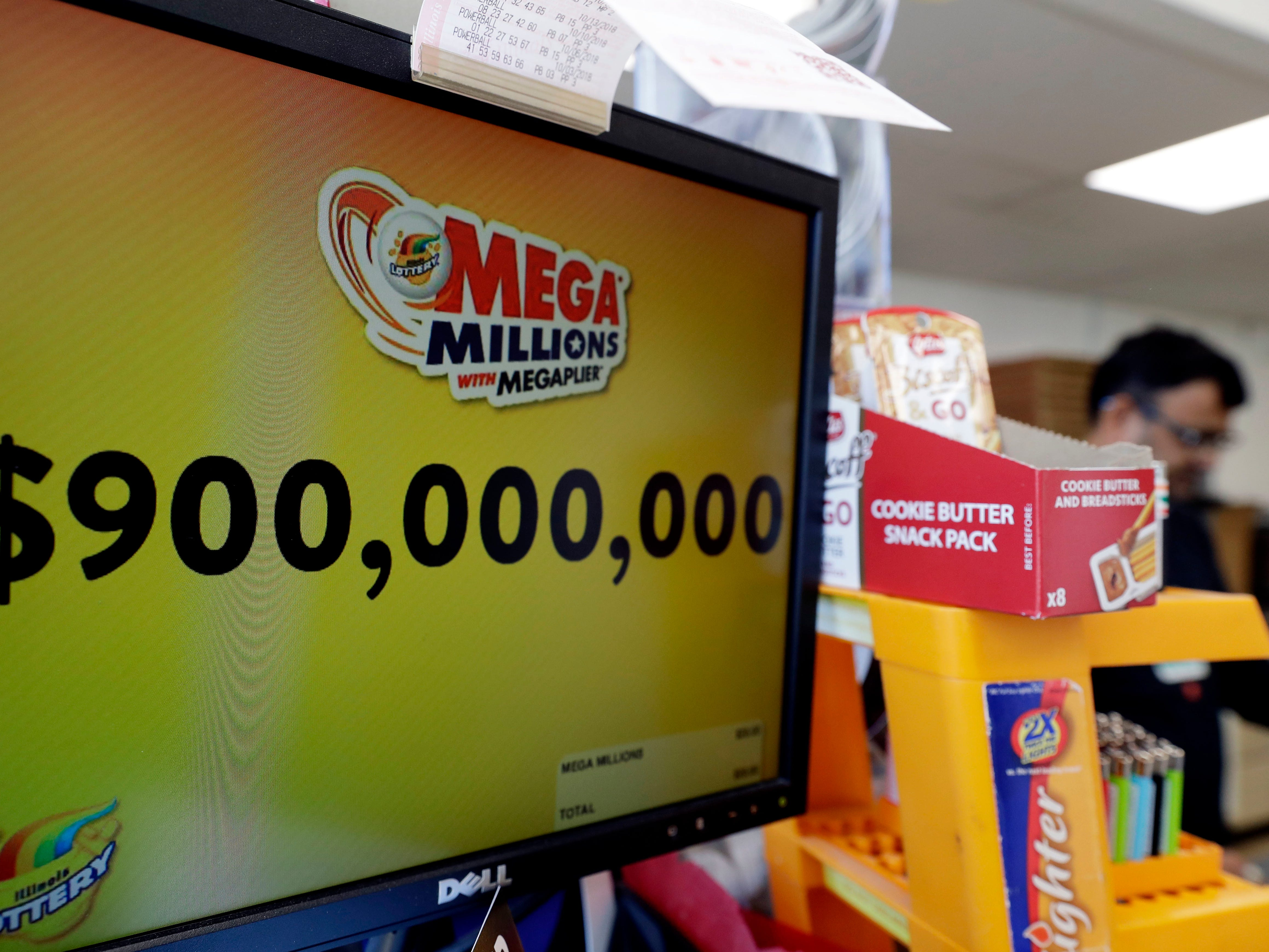 The Mega Millions jackpot is displayed at a convenience store Wednesday, Oct. 17, 2018, in Chicago.