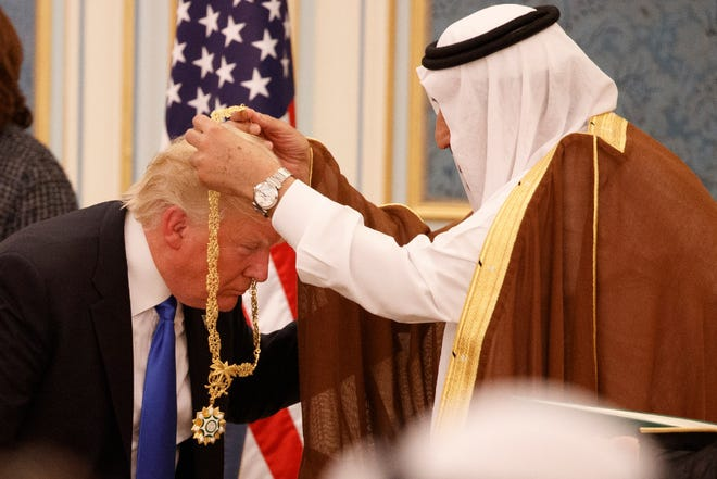 Saudi King Salman presents President Donald Trump with the highest civilian honor, the Collar of Abdulaziz Al Saud, Riyadh, Saudi Arabia, May 20, 2017.