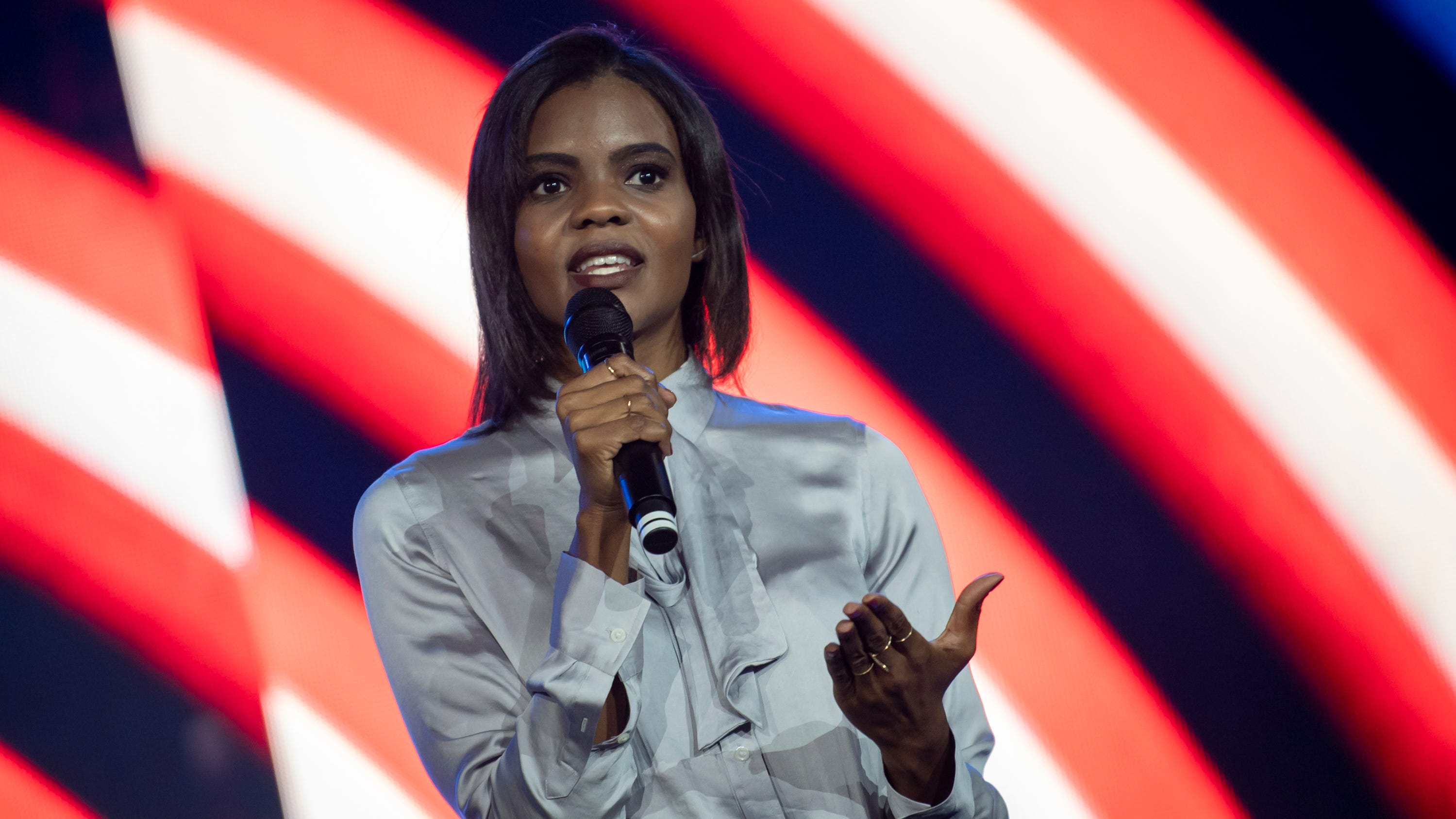"Candace Owens often tells a story from high school where a group of boys left voicemails on her phone where they made threats and called her racial slurs. It affected her personally and later, politically. She now preaches against victimhood, especially among African Americans. Here she is speaking to students at Liberty University on Sept. 26. ""I had no interest in politics whatsoever prior to 2015,"" she said."
