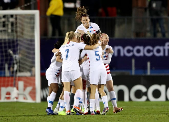 U.S. midfielder Rose Lavelle, center, is hoisted by her teammates after scoring a goal less than two minutes in Wednesday's championship match.