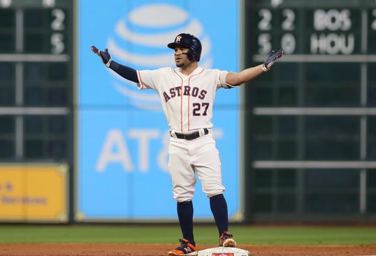ALCS Game 4: Astros second baseman Jose Altuve is called out after a fan interference call on a home run in the first inning.