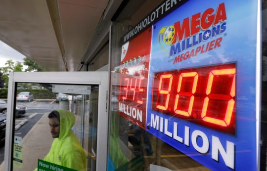 The Mega Millions jackpot is displayed as a customer leaves the Corner Market, Wednesday, Oct. 17, 2018, in Lyndhurst, Ohio.