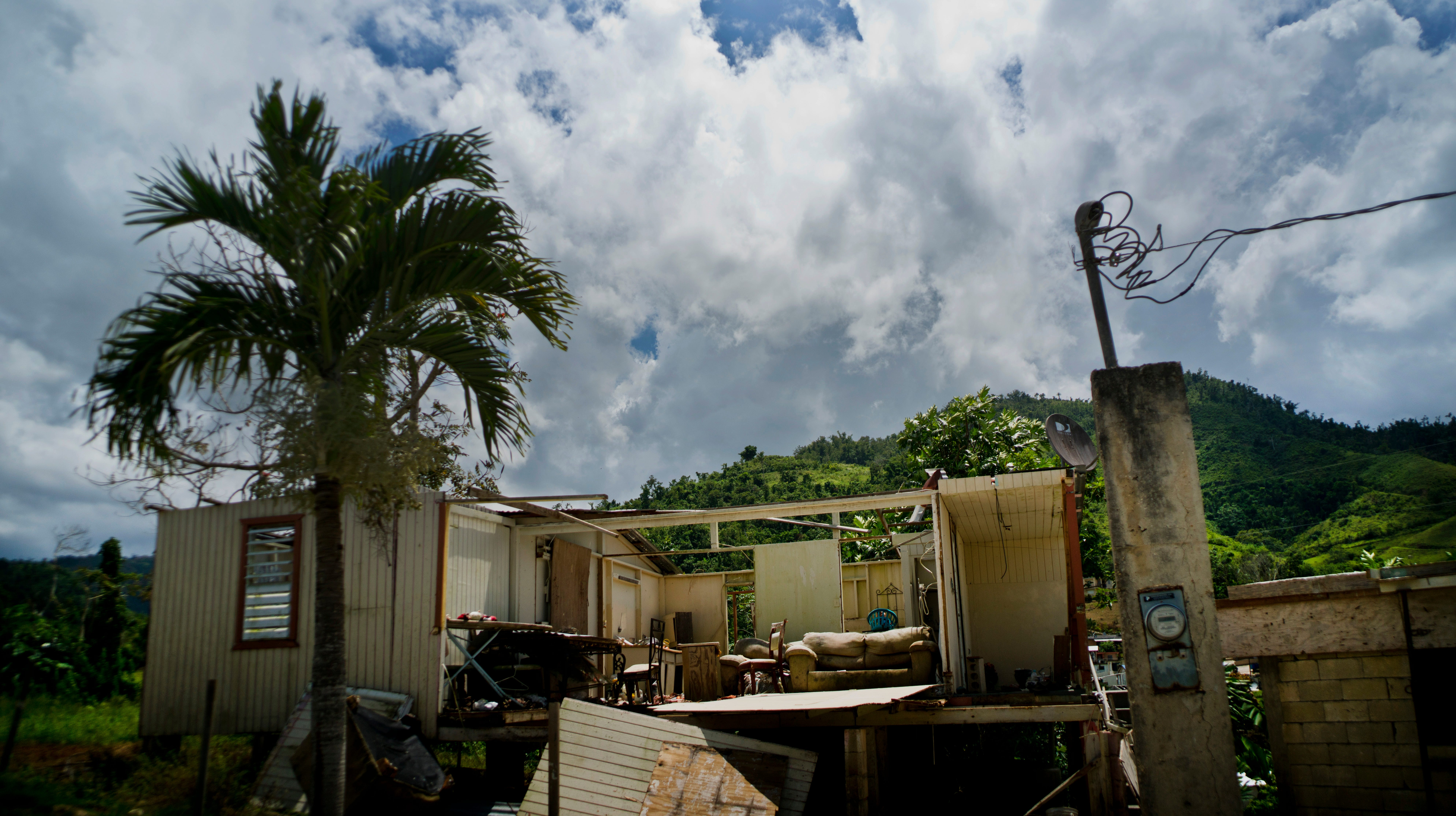 In this Sept. 8, 2018 photo, a home that was abandoned after Hurricane Maria hit one year ago stands full of furniture in the San Lorenzo neighborhood of Morovis, Puerto Rico.