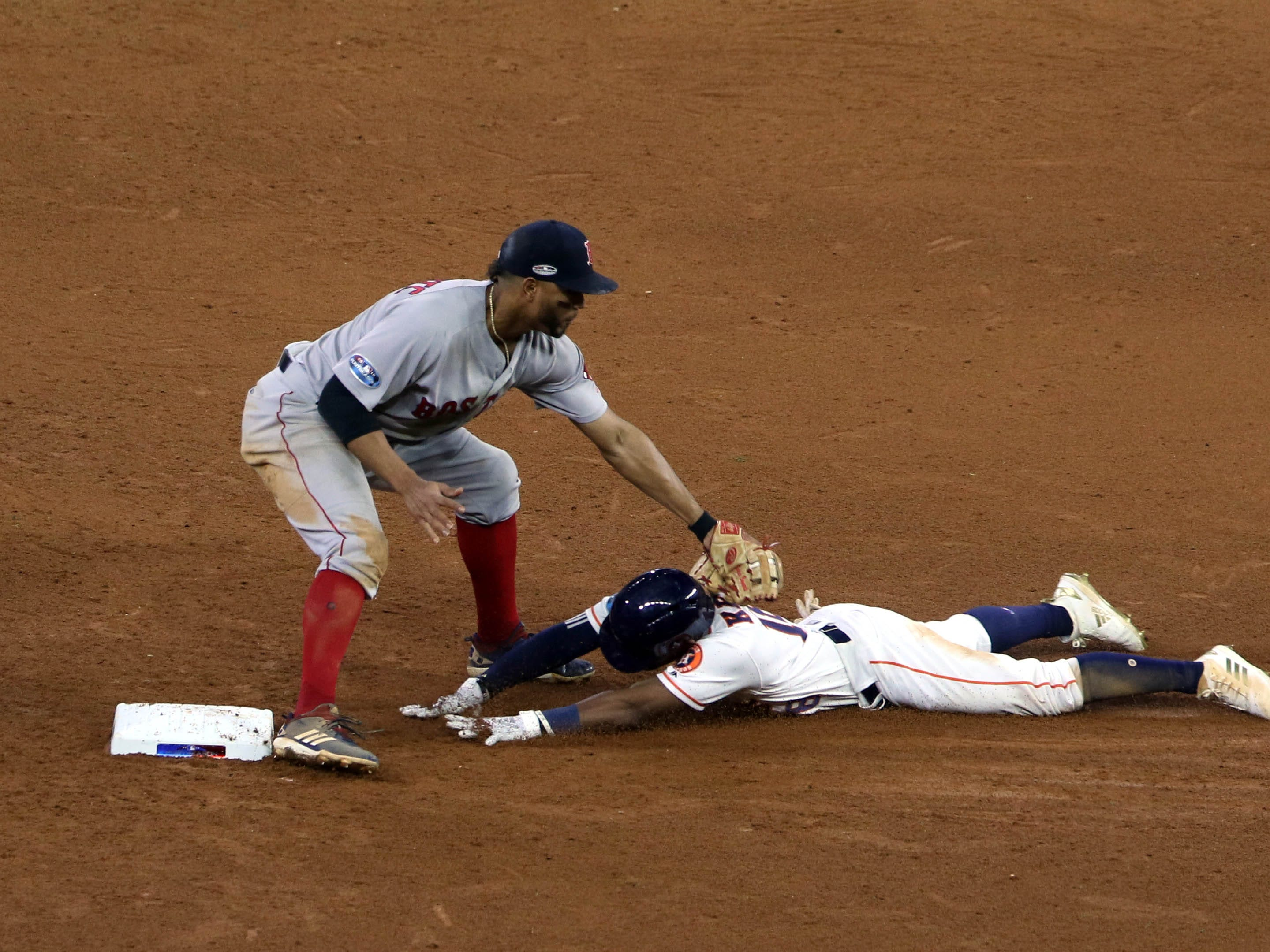 ALCS Game 4: Astros' Tony Kemp is thrown out at second on a throw by Red Sox right fielder Mookie Betts in the eighth inning.