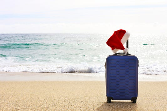 One Hard Shell Suitcase On A Beach Tropical Destination Vacation Concept Santa Claus Hat On Extended Telescoping Luggage Handle
