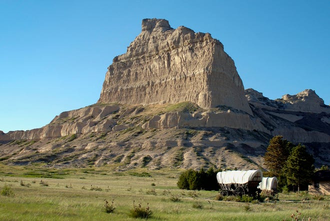 Scott's Bluff, a large stone monolith rising out of the Nebraska prairie, was a beacon to 19th-century travelers moving west on the Oregon Trail and is a tourist attraction today.