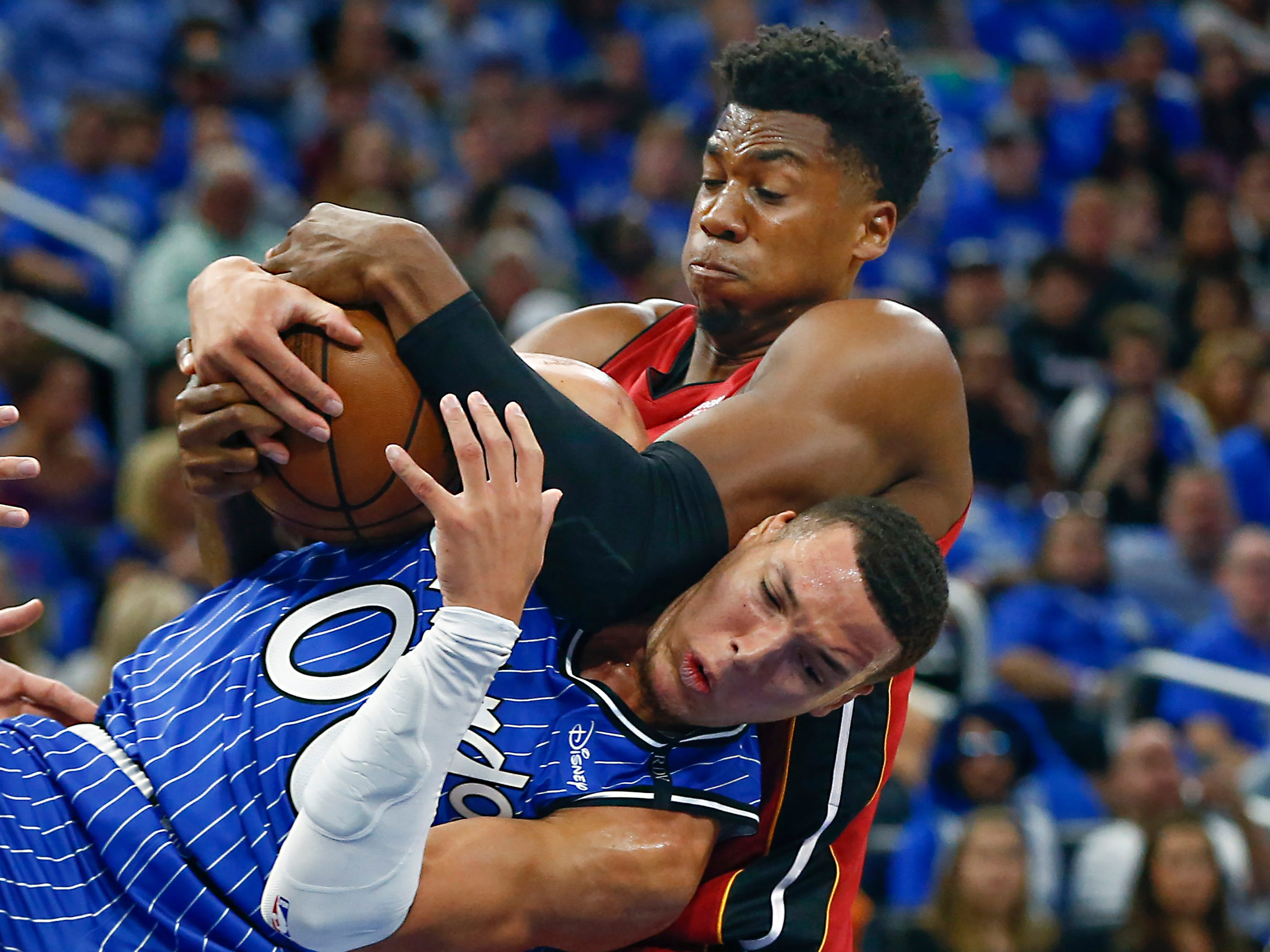 Oct. 17: Orlando Magic forward Aaron Gordon and Miami Heat center Hassan Whiteside battle for the ball during the first quarter at Amway Center.