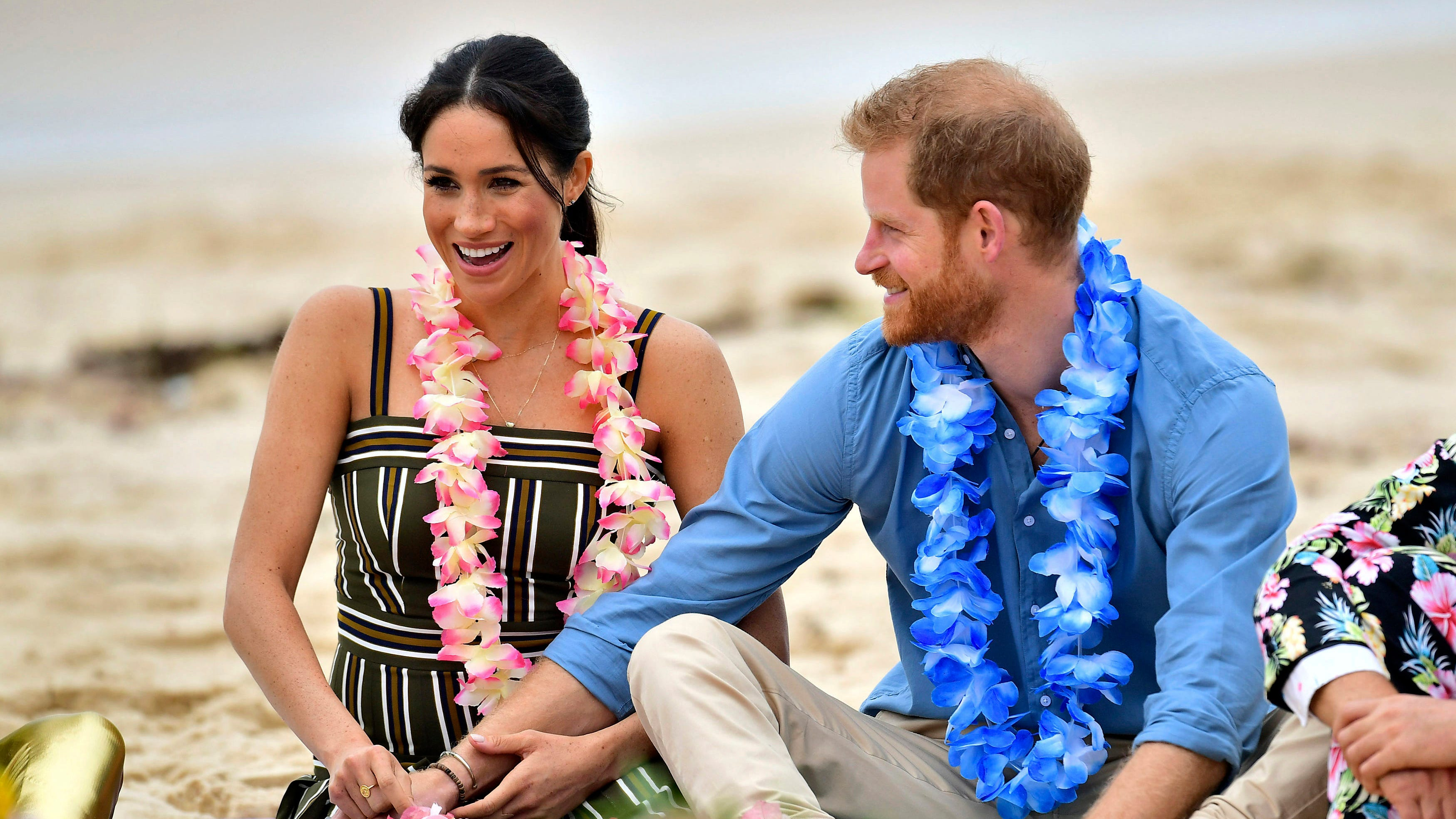 Britain's Prince Harry and Meghan, Duchess of Sussex meet a local surfing community group, known as OneWave, raising awareness for mental health and wellbeing in a fun and engaging way at Bondi Beach Sydney, Australia, Friday, Oct. 19, 2018. Prince Harry and his wife Meghan are on day four of their 16-day tour of Australia and the South Pacific. (Dominic Lipinski/Pool via AP) ORG XMIT: XMB107