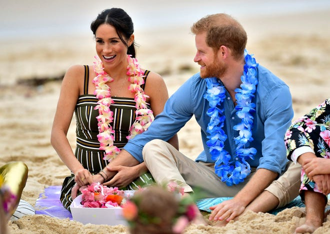 Prince Harry and Duchess Meghan got casual to meet a local surfing community group, OneWave, at Bondi Beach Sydney.