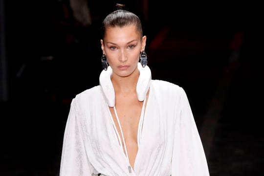 US model Bella Hadid presents a creation by Off-White during the Spring-Summer 2019 Ready-to-Wear collection fashion show in Paris, on September 27, 2018. (Photo by FRANCOIS GUILLOT / AFP)FRANCOIS GUILLOT/AFP/Getty Images ORIG FILE ID: AFP_19I7U8