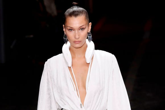 Bella Hadid presents a creation by Off-White during the Spring-Summer 2019 Ready-to-Wear collection fashion show in Paris, on Sept. 27, 2018.