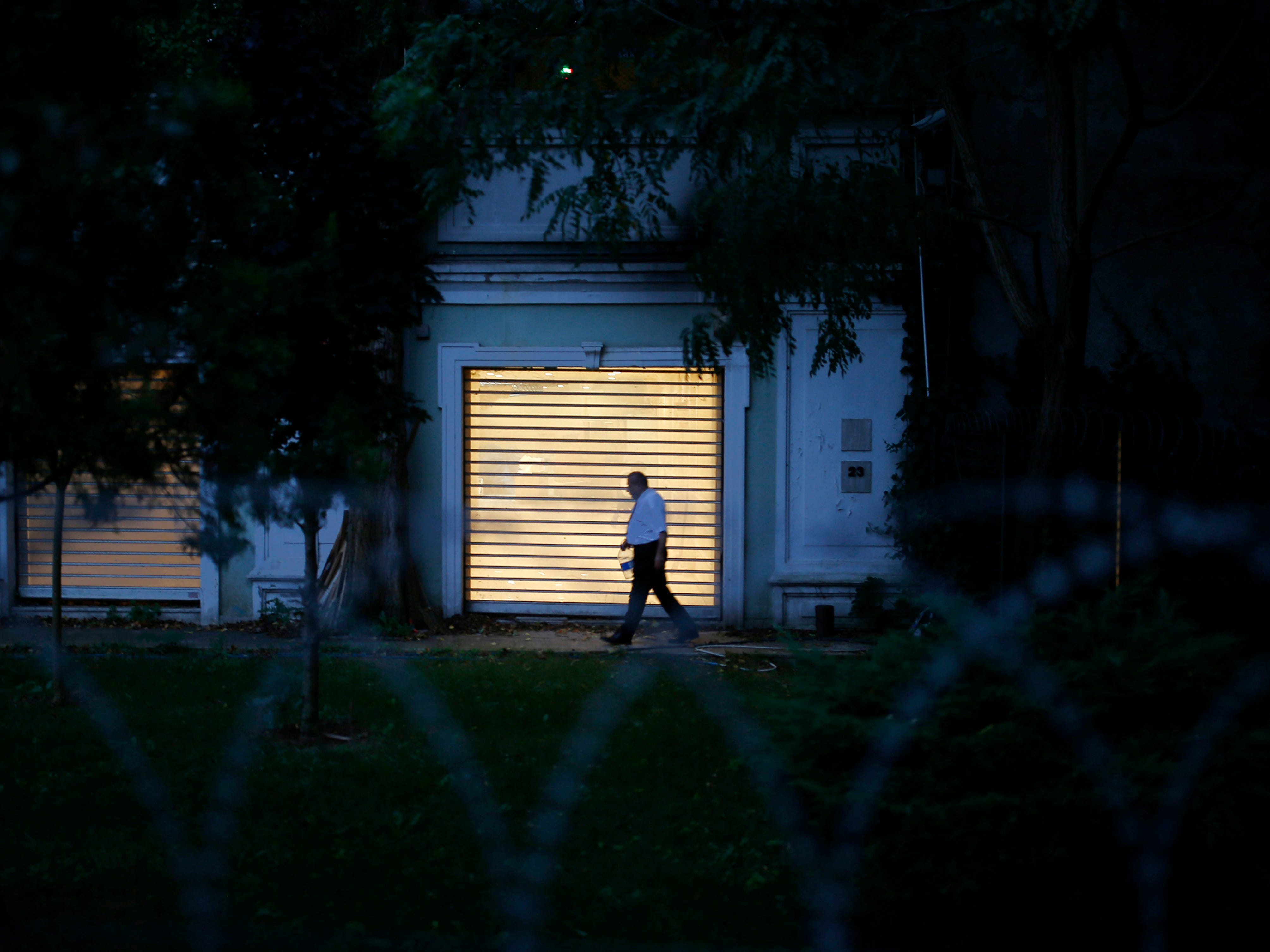 A Turkish police officer walks inside the property of the residence of the Saudi consul General Mohammed al-Otaibi as Turkish police conduct a search after the disappearance and alleged slaying of writer Jamal Khashoggi, in Istanbul, Wednesday, Oct. 17, 2018.