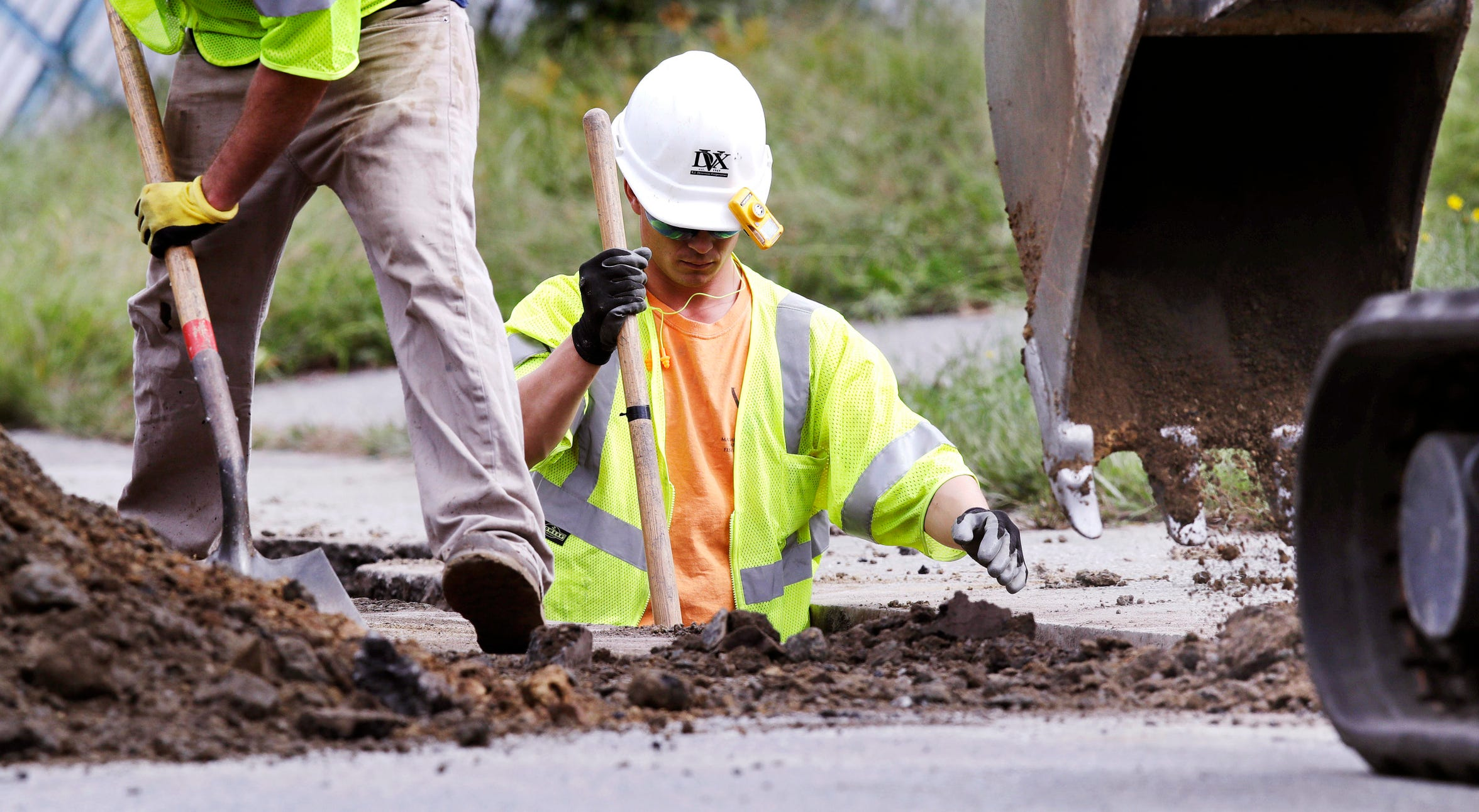 Utility contractors dig up the road above natural gas lines along Dracut Street in Lawrence, Mass., Sept. 20, 2018.