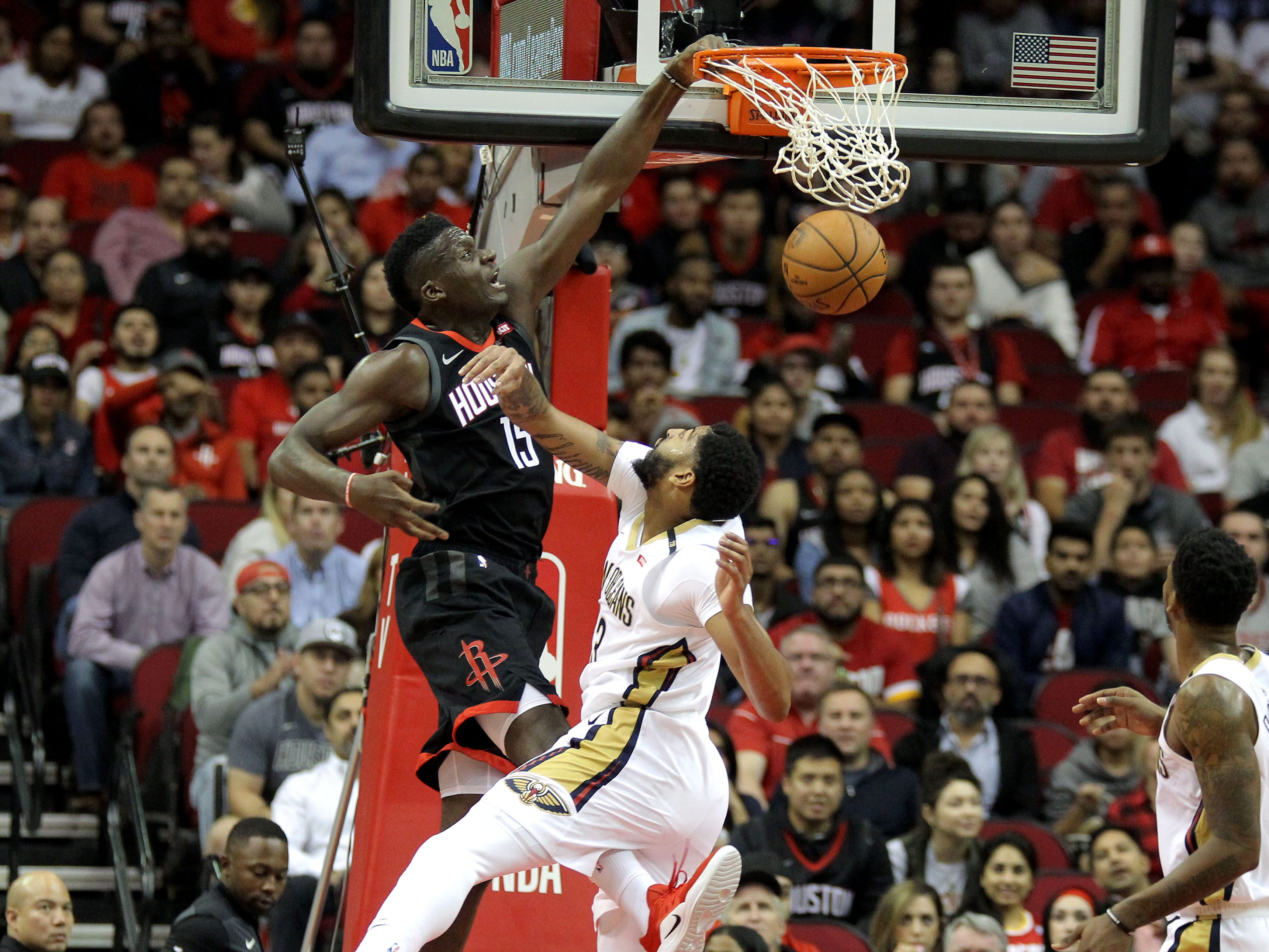 Oct. 17: Houston Rockets center Clint Capela makes a dunk while New Orleans Pelicans forward/center Anthony Davis defends during the first quarter at Toyota Center.